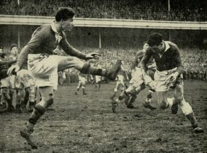 Jackie Kyle kicks for touch against Wales at Cardiff in March 1951.